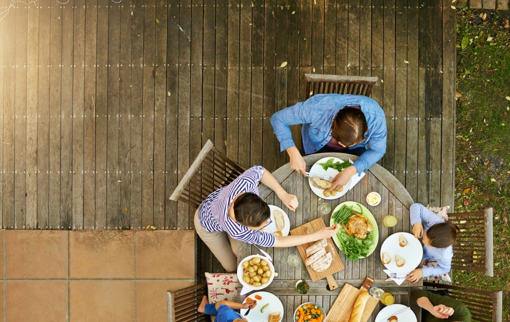 High angle shot of a family enjoying lunch together outside