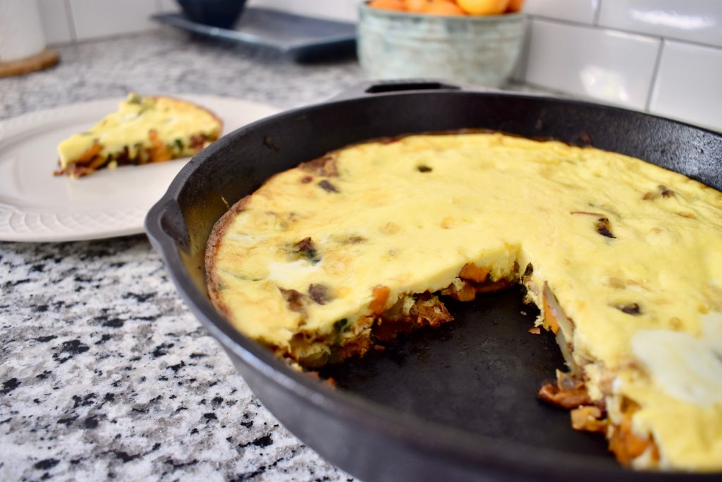 Meat and veggie frittata in cast iron pan