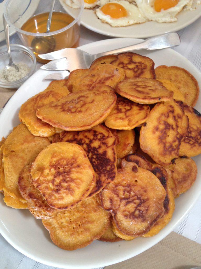 overhead view of a platter of golden pancakes