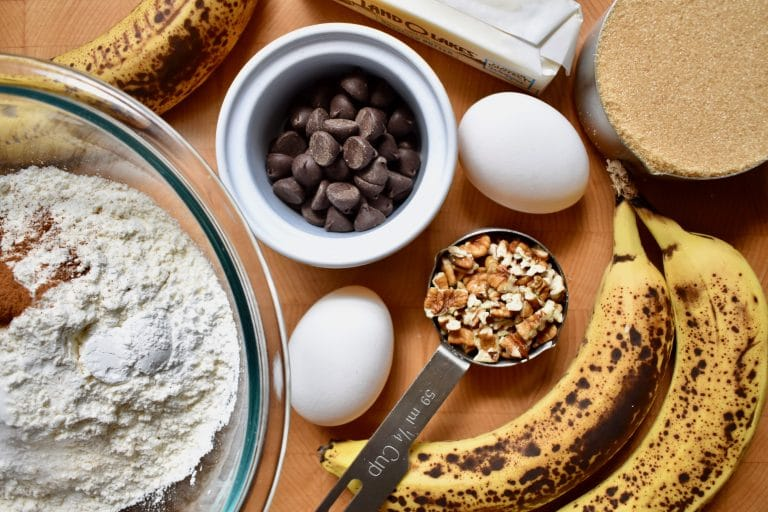 ingredients for banana bread: overripe bananas, flour, eggs, chocolate chips