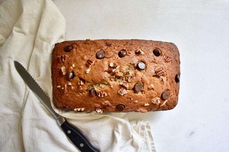 overhead shot of a banana bread loaf with chocolate chips and pecans