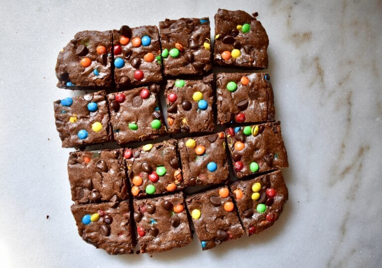 overhead shot of brownies with m&ms, cut into squares